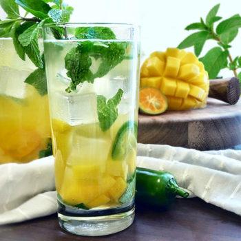 a tall glass of the mangojito described in this recipe