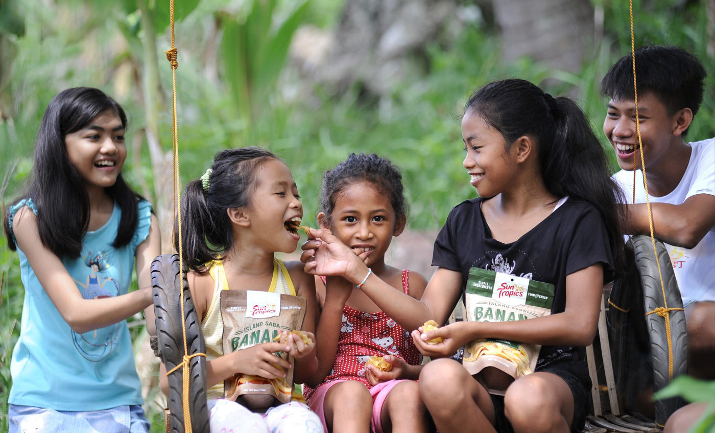 kids on a swing enjoying suntropics