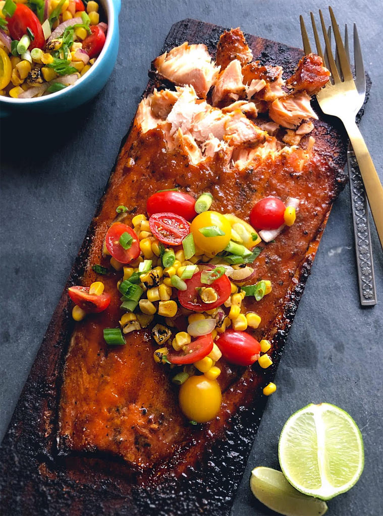 a sumptuous grilled salmon plate covered in delectable garnishes
